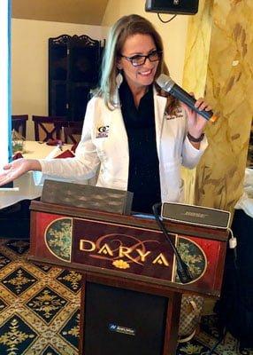 Female Chiropractor Irvine CA Desiree Edlund KOCI Speaking at Radio Show