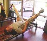 Female Chiropractor Irvine CA Tim Olearts Stretching